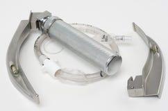 Laryngoscope and intubation tube. Isolated on a white background Stock Photos