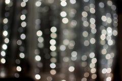 Las bolas color nata del bokeh, guirnalda borrosa, textura, fondo, fotografía están desenfocado, espacio de la copia, abstracto imágenes de archivo libres de regalías