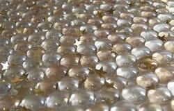 Las bolas con oro stars el fondo Foto de archivo libre de regalías