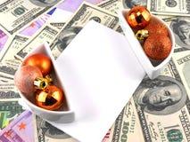 Las bolas de la Navidad fijaron, papel en blanco, fondo del dólar Foto de archivo libre de regalías