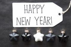Las bolas negras del árbol de navidad, mandan un SMS a Feliz Año Nuevo Fotografía de archivo