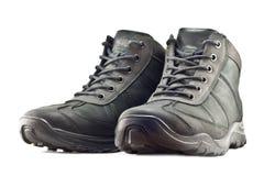 Las botas que caminan de los hombres fotografía de archivo libre de regalías