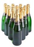 Las botellas de cristal verdes colocan en un fondo blanco en forma los paraministries Imágenes de archivo libres de regalías