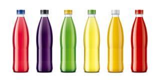 Las botellas para el jugo y otro beben Imagen de archivo libre de regalías