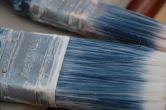 Las brochas utilizaron el azul Foto de archivo libre de regalías