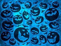 Las calabazas del feliz Halloween con los palos en fondo azul wallpaper Fotos de archivo