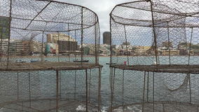 Las Canteras beach through fishing baskets stock video