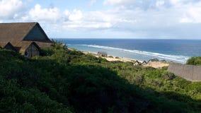 Las casas de madera acercan a la playa Imágenes de archivo libres de regalías