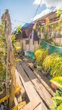 Las casas residenciales en el distrito pobre del ` s de la ciudad coronan Busuanga Vistas de los tugurios del ` s de la ciudad de Imagen de archivo
