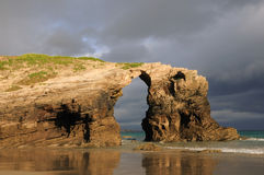 Las Catedrales beach. Ribadeo, Spain. Last ray of sun in the early morning before the rain Royalty Free Stock Image
