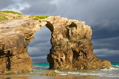 Las Catedrales beach, Ribadeo, Spain. Last ray of sun in the early morning before the rain Stock Photo