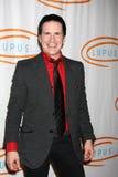 Las chispas de Hal llegan la 12ma bola anual de la naranja del LA del lupus Foto de archivo libre de regalías
