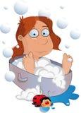 Las coladas de la muchacha en un baño Imagen de archivo