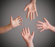 Las cuatro manos de los niños Foto de archivo libre de regalías