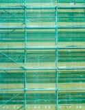 Las cubiertas de nylon de la red montaron el andamio imagen de archivo