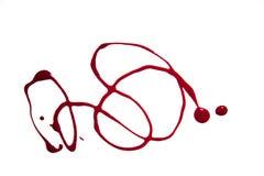 Las curvas hicieron de esmalte de uñas en rojo foto de archivo libre de regalías