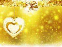 Las decoraciones del corazón de las estrellas de la nieve del amarillo del oro de la Navidad del fondo empañan Año Nuevo del ejem Fotos de archivo