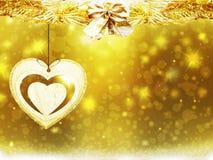 Las decoraciones del corazón de las estrellas de la nieve del amarillo del oro de la Navidad del fondo empañan Año Nuevo del ejem Foto de archivo