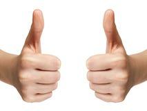Las demostraciones adolescentes femeninas de las manos manosean con los dedos para arriba Imagen de archivo libre de regalías
