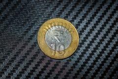 Las diez rupias indias acuñan fotografía de archivo
