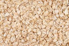 Las escamas de la harina de avena se cierran para arriba Imagen de archivo libre de regalías