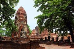 Las esculturas de Buda hicieron de roca en las ruinas del templo de Wat Phra Sri Sanphet Ayutthaya, Tailandia fotos de archivo