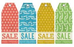 Las etiquetas de la Navidad del vintage con venta ofrecen, vector Fotografía de archivo