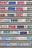 Las etiquetas engomadas de la publicidad en un rodillo del metal shutter, Yangshou, China Imagen de archivo libre de regalías