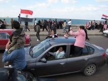Las familias ensamblaron las demostraciones egipcias Foto de archivo libre de regalías