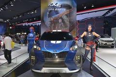 Las figuras de X-Men en el coche del salón de KIA KX5 Imagen de archivo libre de regalías
