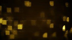 Las filas amarillas de símbolos abstractos y de cuadrados empañaron luces Fotos de archivo