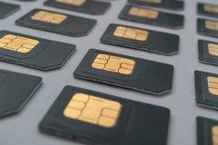 Las filas SIM cardan estirar en la distancia, filas de las tarjetas de SIM Imagen de archivo libre de regalías