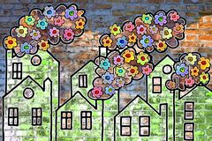 Las flores coloreadas salen de las chimeneas de las casas - imagen del concepto fotos de archivo