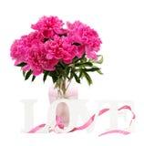 Flores rosadas del peony en florero Foto de archivo