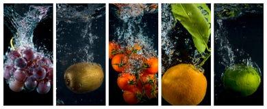 Las frutas y verduras que caen en el agua con salpican y burbujean Imagen de archivo libre de regalías