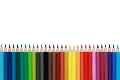 Las fuentes de escuela colorearon los lápices para los estudiantes con el copyspace foto de archivo libre de regalías