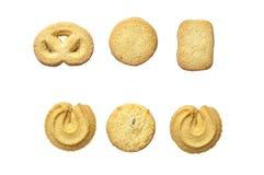 Las galletas clásicas son marrón de oro en el fondo blanco Imagen de archivo libre de regalías