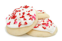 Las galletas con la formación de hielo y el corazón blancos asperjan Fotografía de archivo