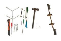 Las herramientas del artesano con el pie fijan la pieza de la motocicleta aislada en wh Fotos de archivo libres de regalías