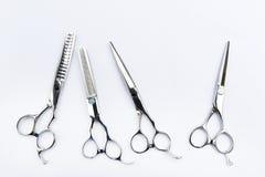 Las herramientas del peluquero aisladas en fondo Fotos de archivo libres de regalías