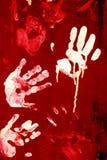 Las impresiones, las palmas manchadas en una pintura en el metal Imágenes de archivo libres de regalías