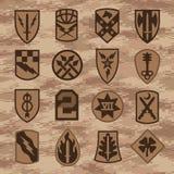 Las insignias del remiendo de la unidad militar fijaron en camuflaje del moreno libre illustration