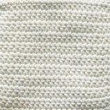 Las lanas hicieron punto la tela como fondo y textura imagen de archivo
