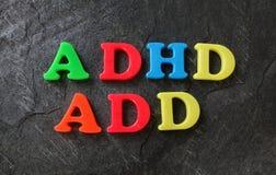 Las letras AÑADA y de ADHD Imágenes de archivo libres de regalías