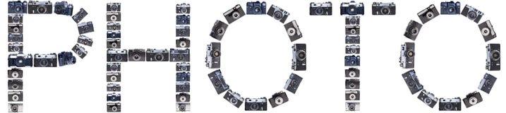 Las letras de cámaras retras viejas aislaron el fondo Imágenes de archivo libres de regalías