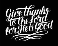 Las letras de la mano con verso de la biblia dan gracias al señor, porque él es bueno en fondo negro salmo ilustración del vector