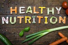 Las letras de los canapes vegetales construyen la nutrición sana del texto foto de archivo