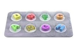 Las letras del alfabeto les gusta píldoras en ampolla Foto de archivo
