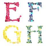Las letras E, F, G y H hechos de botones Imagen de archivo