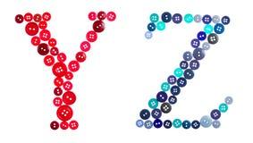 Las letras Y y Z hechos de botones fotografiados Imagen de archivo